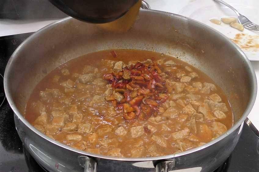 Paso 5 de Paella de arroz con magro de cerdo y verduras de temporada