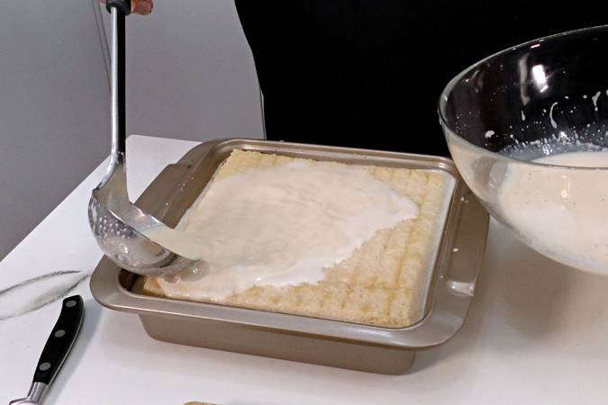 Paso 4 de Pudin de melocotón en almíbar con bizcocho