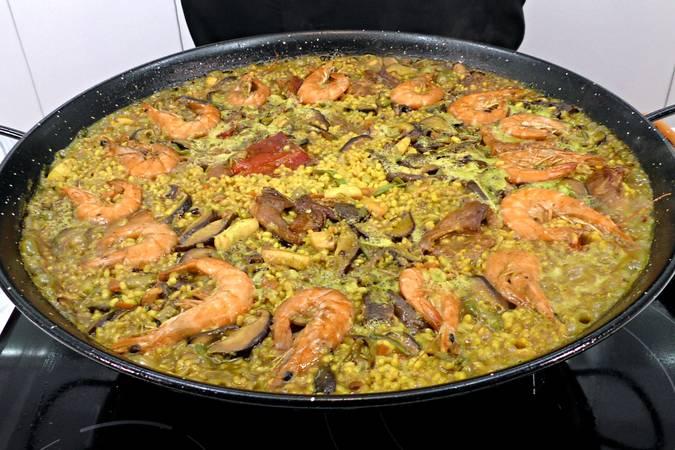 Paso 8 de Paella de arroz mar y montaña